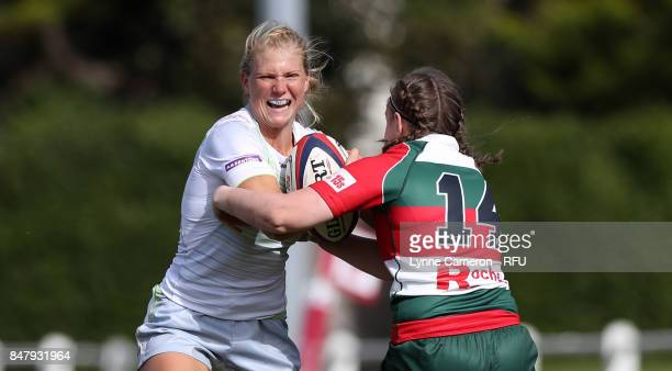 Eloise Bloomfield of Saracens Women is caught by Michelle Davis of Firwood Waterloo Ladies during the Tyrrells Premier 15 at The Memorial Ground on...