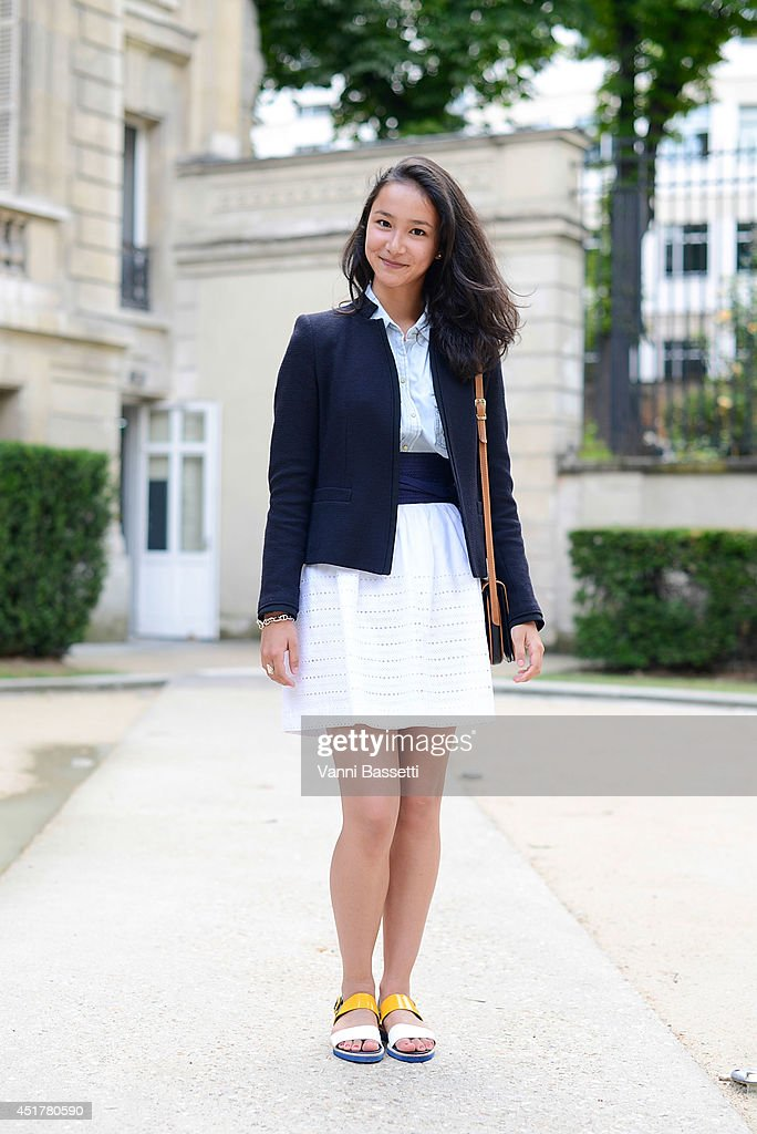 Eloise Goh poses wearing a Gerard Darel jacket, Zara shirt,Tara Jarmon skirt and Carel shoes before Stephanie Coudert show on July 6, 2014 in Paris, France.