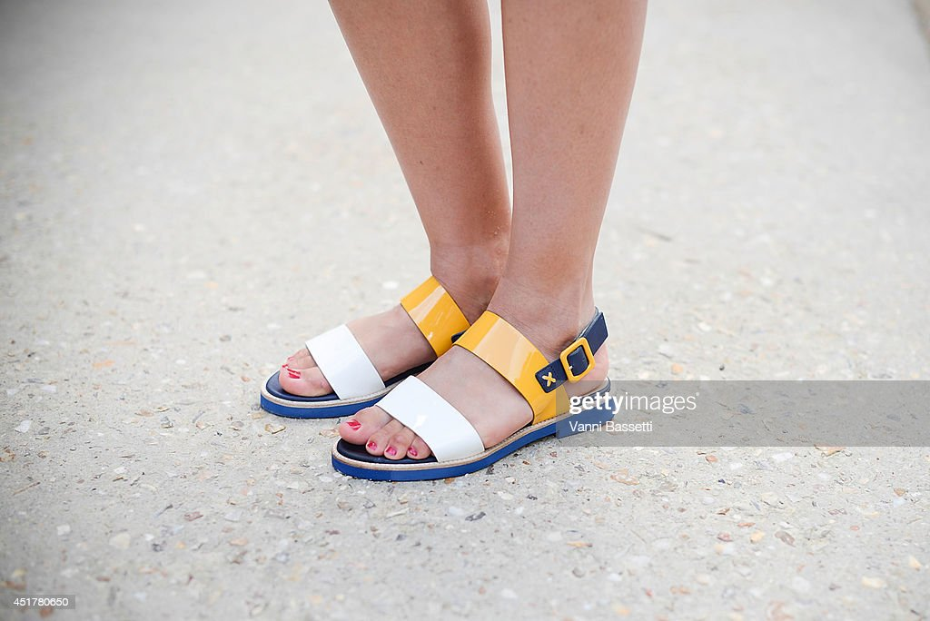 Eloise Goh poses wearing Carel shoes before Stephanie Coudert show on July 6 2014 in Paris France