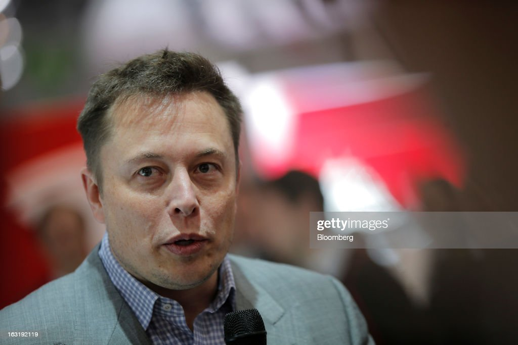 Elon Musk, billionaire and chief executive officer of Tesla Motors Inc., speaks to the media on the first day of the 83rd Geneva International Motor Show in Geneva, Switzerland, on Tuesday, March 5, 2013. This year's show opens to the public on Mar. 7, and is set to feature more than 100 product premiers from the world's automobile manufacturers. Photographer: Valentin Flauraud/Bloomberg via Getty Images