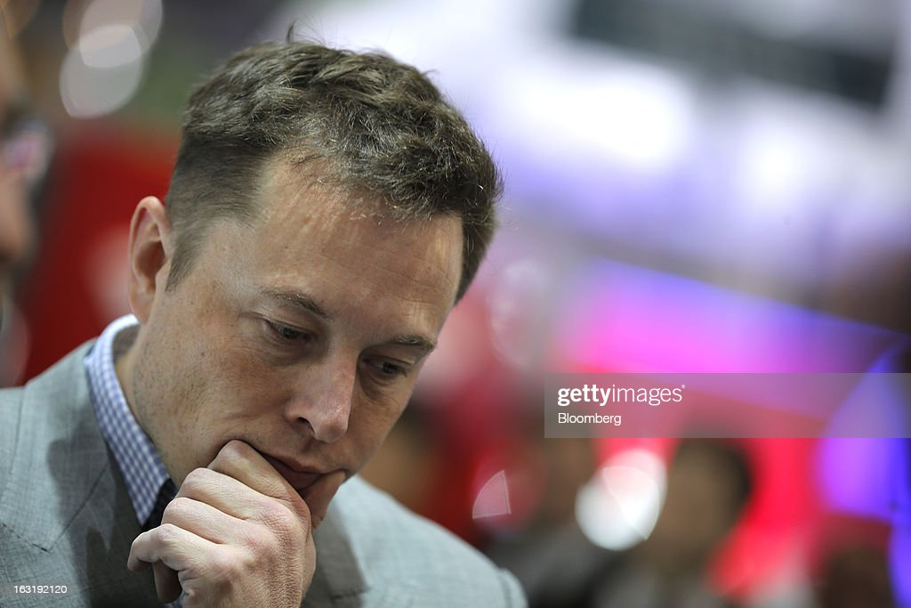 Elon Musk, billionaire and chief executive officer of Tesla Motors Inc., pauses as he speaks to the media on the first day of the 83rd Geneva International Motor Show in Geneva, Switzerland, on Tuesday, March 5, 2013. This year's show opens to the public on Mar. 7, and is set to feature more than 100 product premiers from the world's automobile manufacturers. Photographer: Valentin Flauraud/Bloomberg via Getty Images