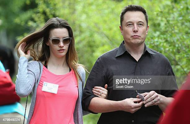 Elon Musk CEO and CTO of SpaceX CEO and product architect of Tesla Motors and chairman of SolarCity and his wife Talulah Riley attend the Allen...