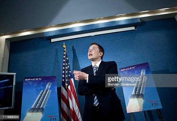 Elon Musk CEO of Space Exploration Technologies Corp pauses while speaking during a news conference at the National Press Club April 5 2011 in...