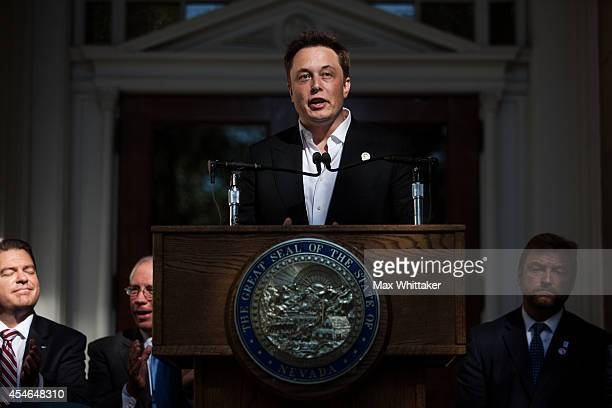 Elon Musk CEO of Tesla Motors speaks at a press conference at the Nevada State Capitol September 4 2014 in Carson City Nevada Musk and Sandoval...
