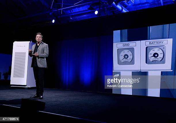 Elon Musk CEO of Tesla with a Powerpack system in the background unveils suite of batteries for homes businesses and utilities at the Tesla Design...