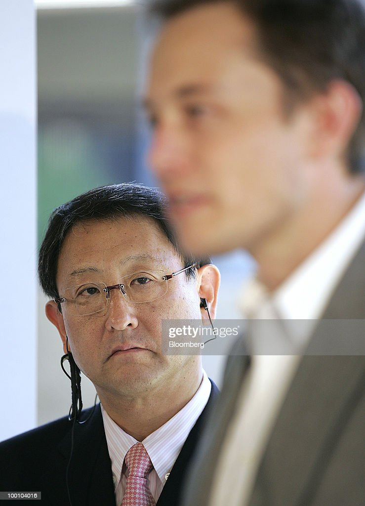 Elon Musk, chairman and chief executive officer of Tesla Motors Inc., right, speaks as Akio Toyoda, president of Toyota Motor Corp., listens during a news conference at the Tesla Motors Inc. headquarters in Palo Alto, California, U.S., on Thursday, May 20, 2010. Toyota Motor Corp. will acquire a $50 million stake in California electric-car maker Tesla Motors Inc. as automakers compete to introduce less-polluting vehicles in the U.S. Photographer: Tony Avelar/Bloomberg via Getty Images