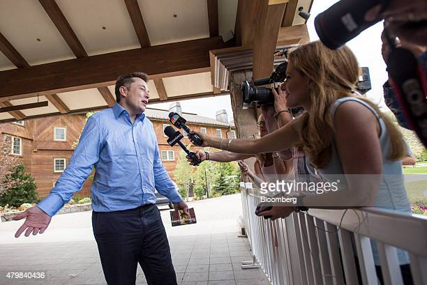 Elon Musk chairman and chief executive officer of Tesla Motors Inc speaks to the media as he arrives for the Allen Co Media and Technology Conference...