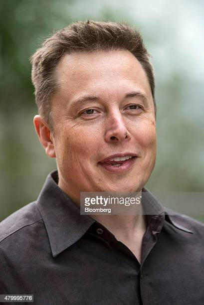 Elon Musk chairman and chief executive officer of Tesla Motors Inc walks the grounds after a morning session during the Allen Co Media and Technology...