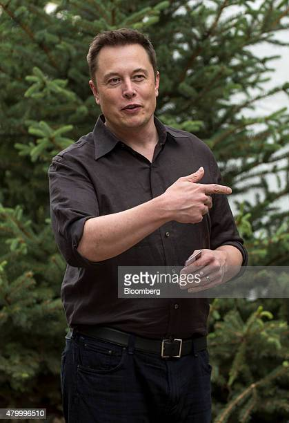 Elon Musk chairman and chief executive officer of Tesla Motors Inc stops to talk to the media as he walks the grounds after a morning session during...