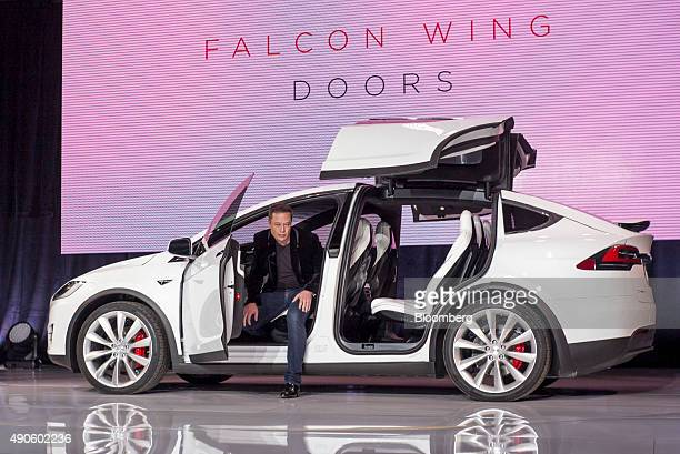 Elon Musk chairman and chief executive officer of Tesla Motors Inc exits the Model X sport utility vehicle during an event in Fremont California US...