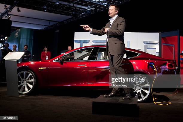 Elon Musk chairman and chief executive officer of Tesla Motors Inc speaks in front of a Tesla Model S electric car on day two of the 2010 North...
