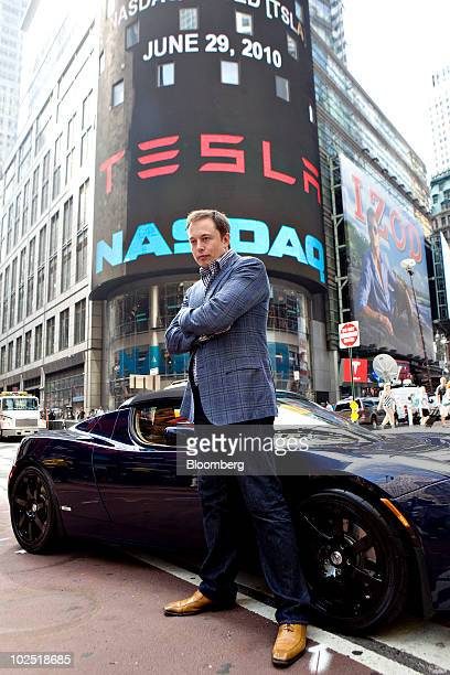 Elon Musk chairman and chief executive officer of Tesla Motors stands for a portrait with a Tesla Roadster outside the Nasdaq Marketsite in New York...