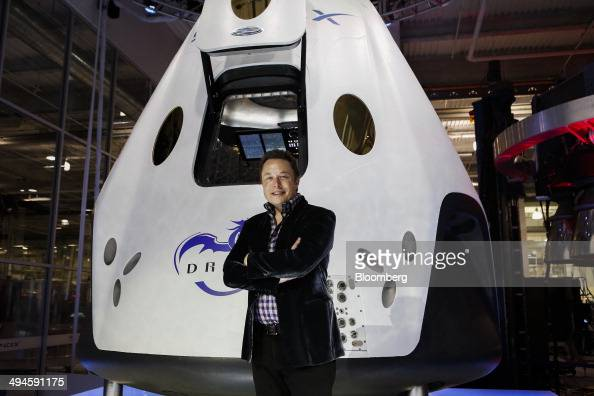 Elon Musk chief executive officer of Space Exploration Technologies Corp stands for a photograph at the unveiling of the Manned Dragon V2 Space Taxi...