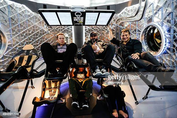 Elon Musk chief executive officer of Space Exploration Technologies Corp left sits with guests inside the Manned Dragon V2 Space Taxi in Hawthorne...