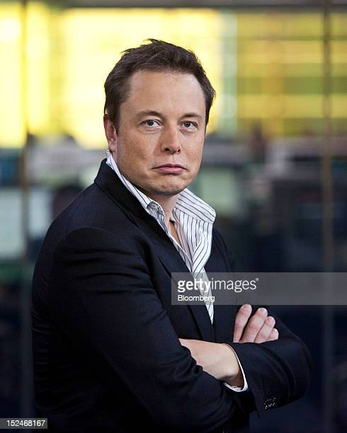 Elon Musk cofounder and chief executive officer of Tesla Motors Inc poses for a photograph during a break in a Bloomberg Television interview in New...