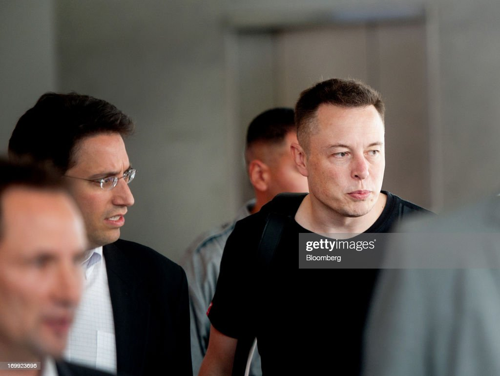 <a gi-track='captionPersonalityLinkClicked' href=/galleries/search?phrase=Elon+Musk&family=editorial&specificpeople=4448862 ng-click='$event.stopPropagation()'>Elon Musk</a>, co-founder and chief executive officer of Tesla Motors Inc., right, arrives for his company's annual shareholders meeting in Mountain View, California, U.S., on Tuesday, June 4, 2013. Musk said Tesla stores will expand to 50 from 34 this year and the service network is expected to double by year-end. Photographer: Noah Berger/Bloomberg via Getty Images