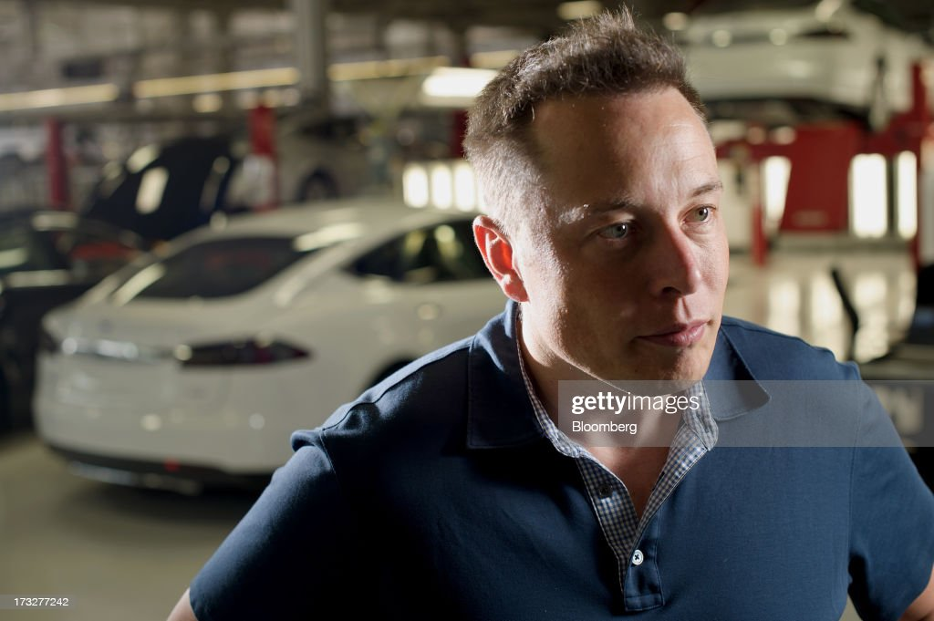 <a gi-track='captionPersonalityLinkClicked' href=/galleries/search?phrase=Elon+Musk&family=editorial&specificpeople=4448862 ng-click='$event.stopPropagation()'>Elon Musk</a>, co-founder and chief executive officer of Tesla Motors Inc., speaks during an interview at the company's assembly plant in Fremont, California, U.S., on Wednesday, July 10, 2013. Tesla, is building Model S electric sedans faster than its initial 400-a-week goal as demand and the companys production skills increase, Musk said. Photographer: Noah Berger/Bloomberg via Getty Images