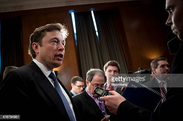 Elon Musk cofounder and chief executive officer of Tesla Motors Inc and Space Exploration Technologies Corp left speaks to members of the media...