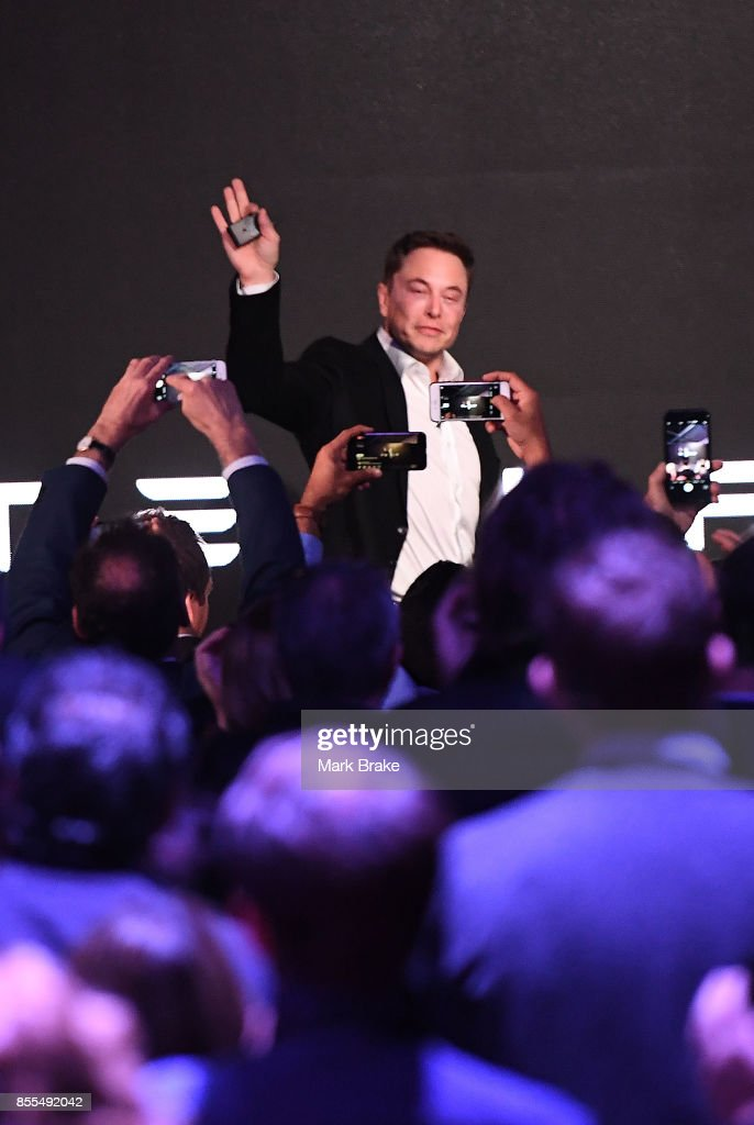 Elon Musk waves to the crowd as he finishes his presentation during Tesla Powerpack Launch Event at Hornsdale Wind Farm on September 29, 2017 in Adelaide, Australia. Tesla will build the world's largest lithium ion battery after coming to an agreement with the South Australian government. The Powerpack project will be capable of an output of 100 megawatts (MW) of power at a time and the huge battery will be able to store 129 megawatt hours (MWh) of energy. Tesla CEO Elon Musk has promised to build the Powerpack in 100 days, or he will deliver it for free.