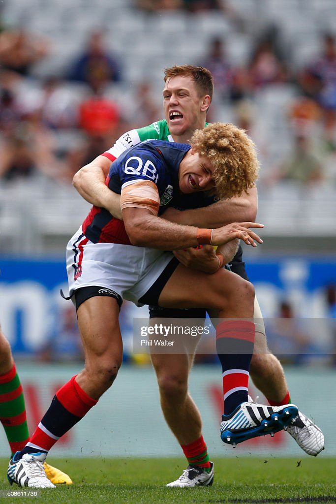 Eloni Vunakece of the Sydney Roosters is tackled during the 2016 Auckland Nines match between the Sydney Roosters and South Sydney at Eden Park on February 6, 2016 in Auckland, New Zealand.