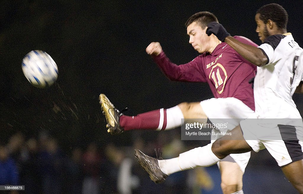 Elon's Daniel Lovitz (11) and Coastal Carolina University's Tevin Skyers (9) go for the ball during a first-round match in the NCAA Men's Soccer Championship in Conway, South Carolina, Thursday, November 15, 2012. Coastal defeated Elon, 3-0.