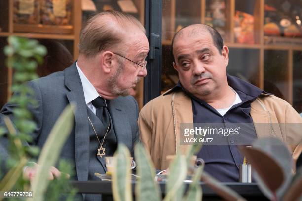 Elor Azaria's father Charlie and defence attorney Yoram Sheftel drink a coffee before holding a press conference on March 1 in the Israeli city of...
