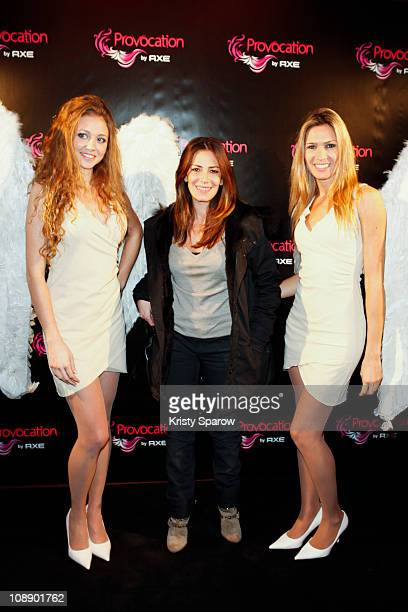 Elsa Fayer poses with models during the 'TRON Legacy 3D' Premiere Hosted By Axe Provocation at Cinema Elysee Biarritz on February 7 2011 in Paris...