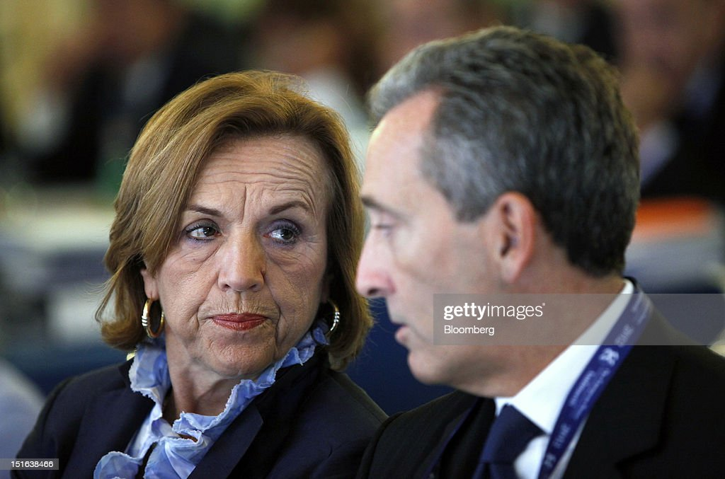 <a gi-track='captionPersonalityLinkClicked' href=/galleries/search?phrase=Elsa+Fornero&family=editorial&specificpeople=8642721 ng-click='$event.stopPropagation()'>Elsa Fornero</a>, Italy's labor minister, left, talks with Vittorio Grilli, Italy's finance minister, as they attend the Ambrosetti Workshop in Cernobbio, near Como, Italy, on Sunday, Sept. 9, 2012. The three day workshop brings together politicians, company executives and economists to the event held in the Italian lakes. Photographer: Alessia Pierdomenico/Bloomberg via Getty Images