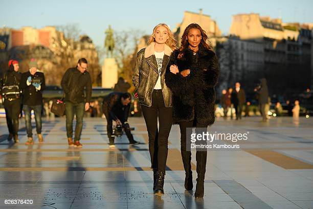 Elsa Hosk and Jasmine Tookes arrive in front of the Eiffel Tower prior the 2016 Victoria's Secret Fashion Show on November 29 2016 in Paris France