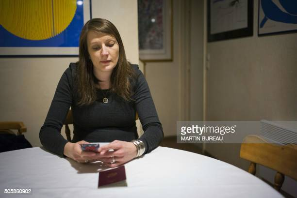 Elsa Lefort a French employee of a research institute of the French embassy in Jerusalem checks her telephone on January 20 2016 at an undisclosed...