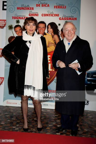 Elsa Martinelli and Carlo Giannelli attend the premiere of ''Natale A Beverly Hills'' at the Warner Moderno Cinema on December 17 2009 in Rome Italy