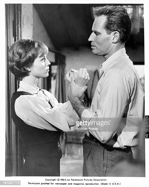 Elsa Martinelli is held by Charlton Heston in a scene from the film 'The Pigeon That Took Rome' 1962