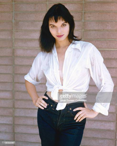 Elsa Martinelli Italian actress and fashion model wearing a white blouse tied at the waist and a pair of denim jeans circa 1970