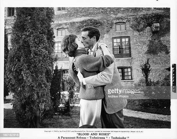 Elsa Martinelli kisses Mel Ferrer in a scene from the film 'Blood And Roses' 1960