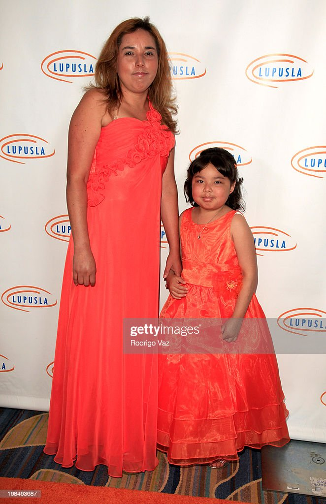 Elsa Rodriguez (L) and Andrea Moreno attend the 13th Annual Lupus LA Orange Ball at the Beverly Wilshire Four Seasons Hotel on May 9, 2013 in Beverly Hills, California.