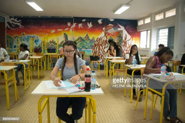 Elsa Verhoye 13yearsold the youngest candidate to sit France's 2017 baccalaureat exams is seen in a classroom at the Lycée of Baimbridge in...