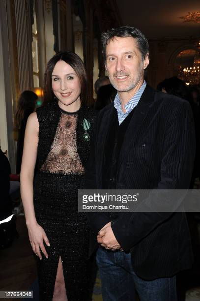 Elsa Zylberstein and Antoine de Caunes pose after she receives the medal 'Chevalier des Arts et lettre' at Ministere de la Culture on April 5 2011 in...