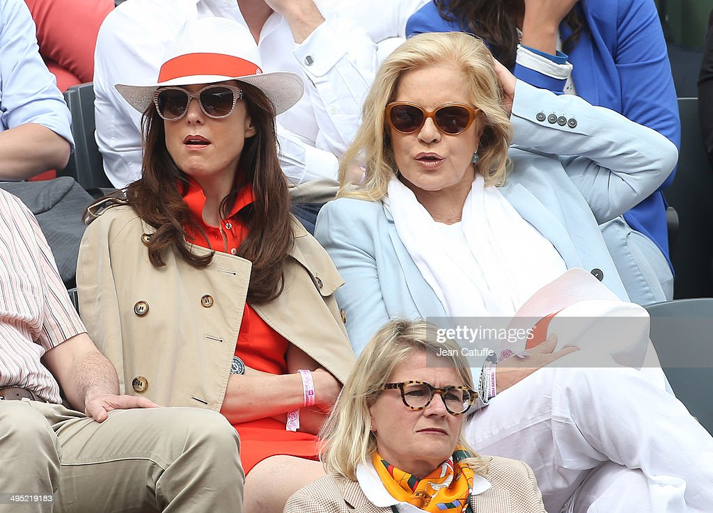 Elsa Zylberstein and Sylvie Vartan attend Day 8 of the French Open 2014 held at Roland-Garros stadium on June 1, 2014 in Paris, France.