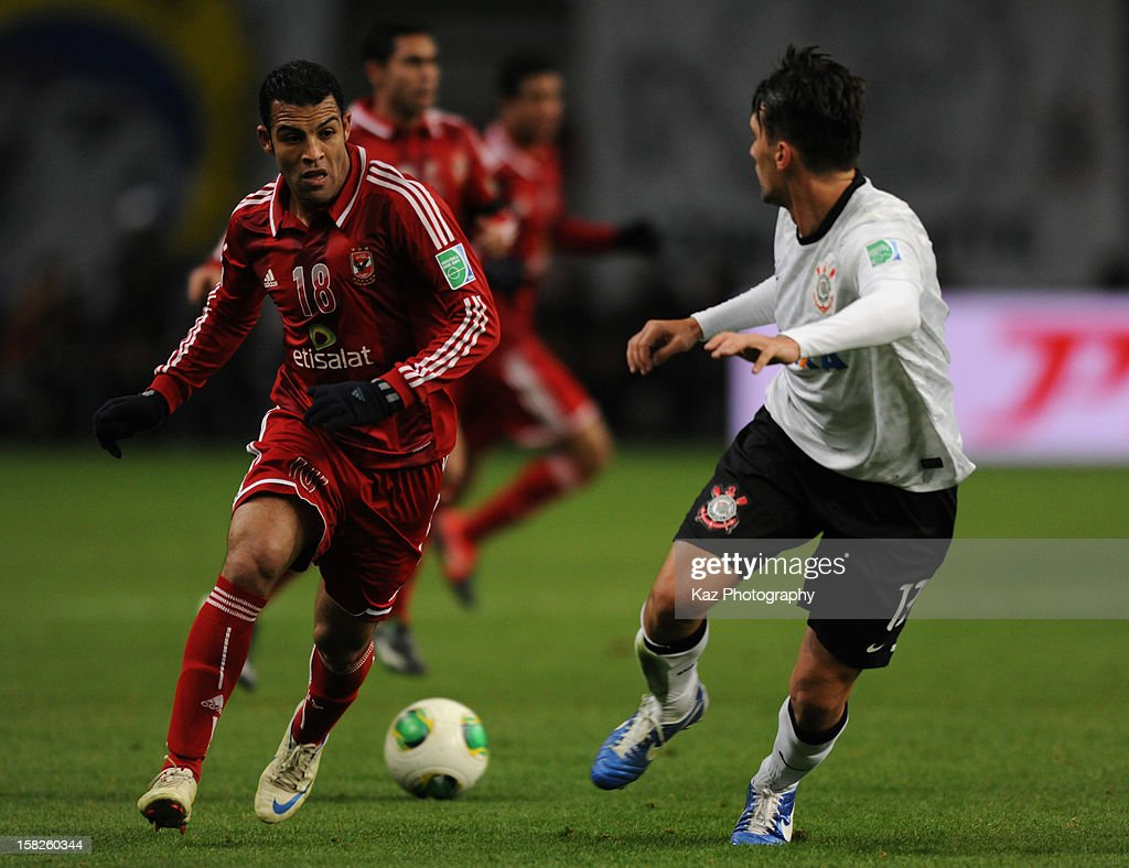 Elsayed Hamdi of Al-Ahly competes with Paulo Andre of Corinthians during the FIFA Club World Cup Semi Final match between Al-Ahly SC and Corinthians at Toyota Stadium on December 12, 2012 in Toyota, Japan.