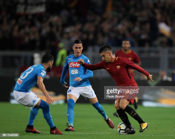 Elseid Hysaj and Jose' Callejon of SSC Napoli compete for the ball with Lorenzo Pellegrini of AS Roma during the Serie A match between AS Roma and...