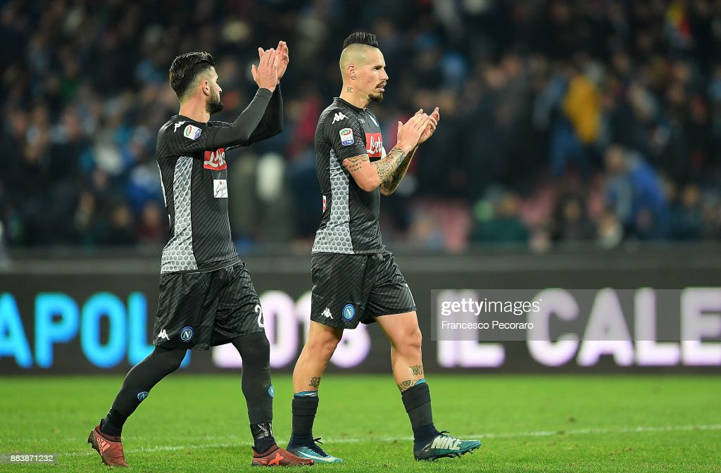 Elseid Hysaj and Marek Hamsik players of SSC Napoli applaud their supporters after the Serie A match between SSC Napoli and Juventus at Stadio San Paolo on December 1, 2017 in Naples, Italy.