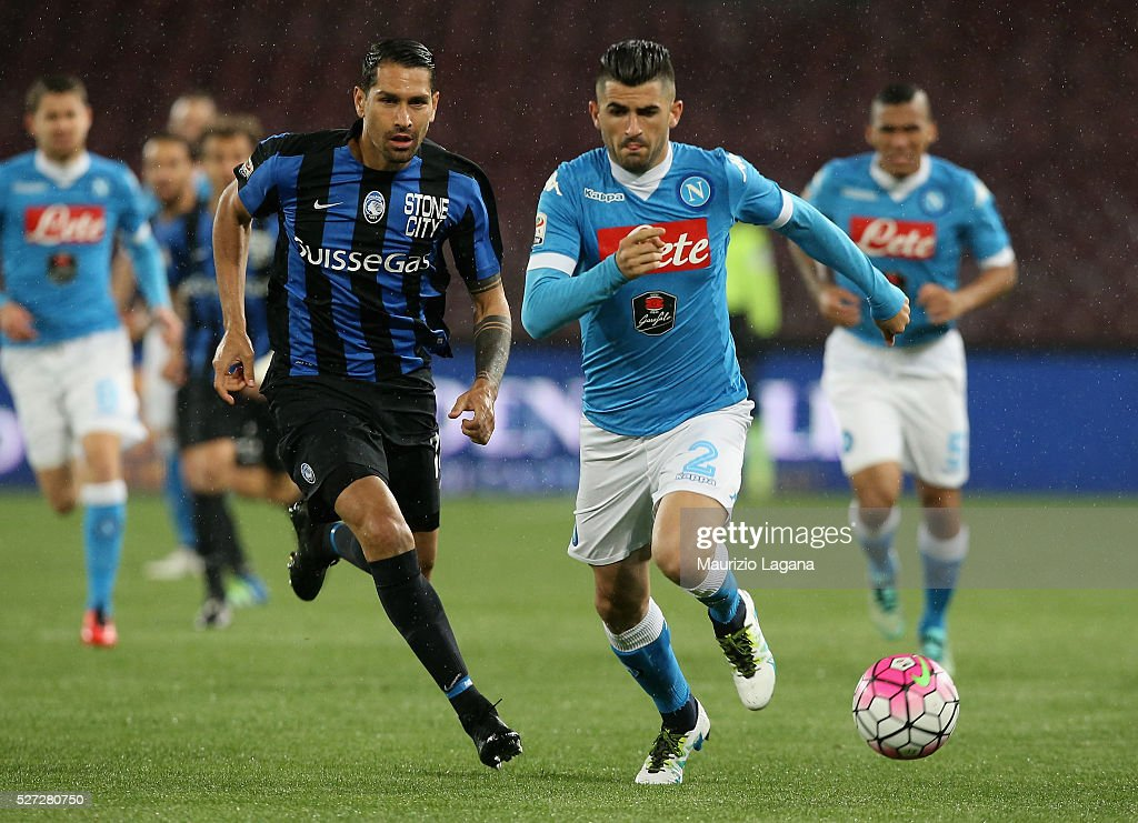 Elseid Hysaj (R) Hamsik of Napoli competes for the ball with Marco Borriello of Atalanta during the Serie A match between SSC Napoli and Atalanta BC at Stadio San Paolo on May 1, 2016 in Naples, Italy.