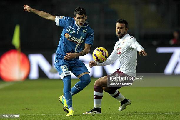 Elseid Hysaj of Empoli FC battles for the ball with Fabio Quagliarella of Torino FC during the Serie A match between Empoli FC and Torino FC at...