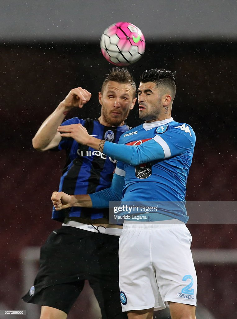 Elseid Hysaj (R) of Napoli competes for the ball in air with Jasmin Kurtic of Atalanta during the Serie A match between SSC Napoli and Atalanta BC at Stadio San Paolo on May 1, 2016 in Naples, Italy.