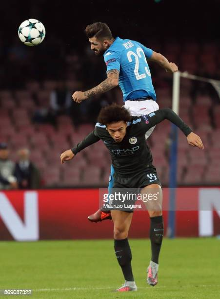 Elseid Hysaj of Napoli competes for the ball in air with Leroy Sanè of Manchester City during the UEFA Champions League group F match between SSC...