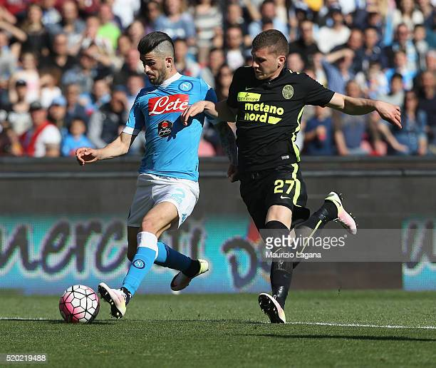 Elseid Hysaj of Napoli competes for the ball with Ante Rebic of Verona during the Serie A match between SSC Napoli and Hellas Verona FC at Stadio San...