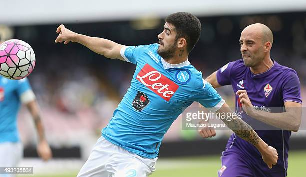 Elseid Hysaj of Napoli competes for the ball with Borja Valero of Fiorentina during the Serie A match between SSC Napoli and ACF Fiorentina at Stadio...
