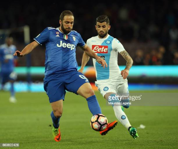 Elseid Hysaj of Napoli competes for the ball with Gonzalo Higuain of Juventus during the Serie A match between SSC Napoli and Juventus FC at Stadio...