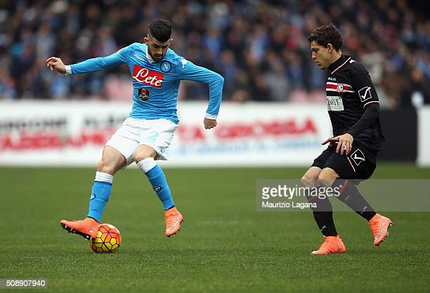 Elseid Hysaj of Napoli competes for the ball with Martinho of Carpi during the Serie A match between SSC Napoli and Carpi FC at Stadio San Paolo on...