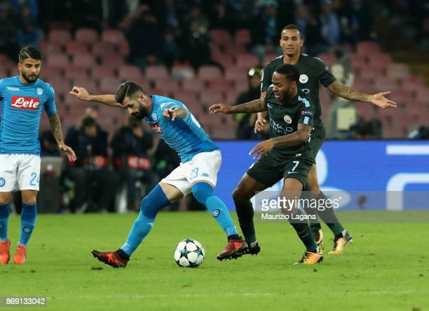 Elseid Hysaj of Napoli competes for the ball with Raheem Starling of Manchester City during the UEFA Champions League group F match between SSC...